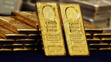 Oro cae por avance del dólar antes de testimonio de Janet Yellen