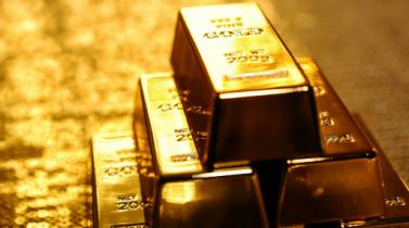 Debilidad del dólar mantiene al oro en camino a su tercera ganancia semanal seguida